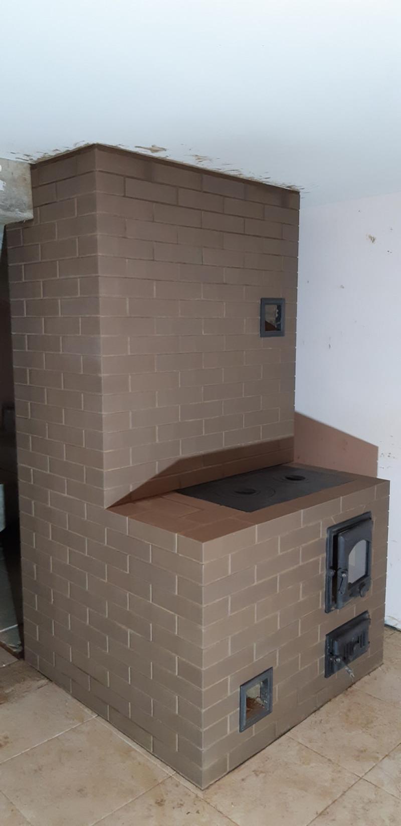 Отопительная печь со встроенным котлом для центрального отопления