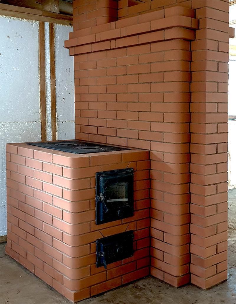 Традиционная отопительно варочная печь с оригинальными доработками под современный стиль дома - готовая печь